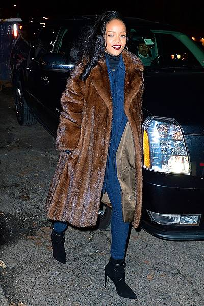 Rihanna rocks a big fur coat and all denim jumpsuit while out in NYC