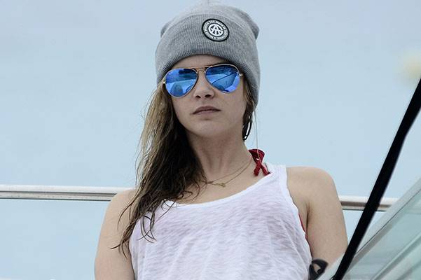 Cara Delevingne is spotted on a boat while on holiday in Barbados