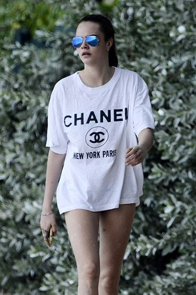 Cara Delevingne hits the beach in a Chanel T-shirt while on holiday in Barbados
