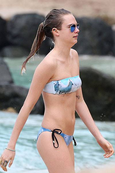 Model Cara Delevingne is pictured at the beach while on holiday in Barbados
