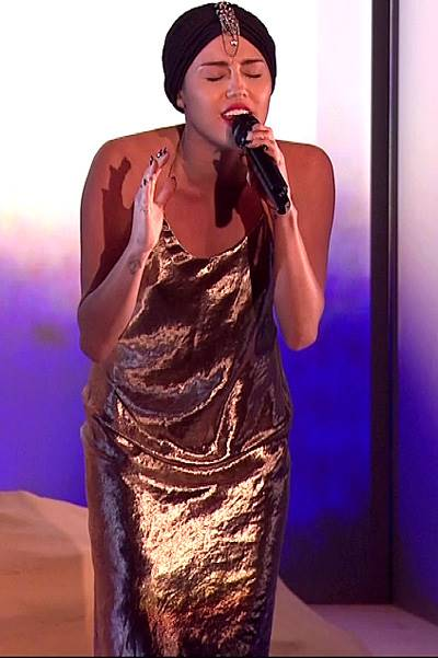 Miley Cyrus performs her new single 'Wrecking Ball' on 'The X Factor - Results', Shown on ITV1 HD Featuring: Miley Cyrus When: 17 Nov 2013 Credit: Supplied by WENN **WENN does not claim any ownership including but not limited to Copyright or License in