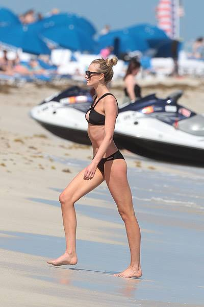 Model Anne V Relaxes On The Beach In Miami