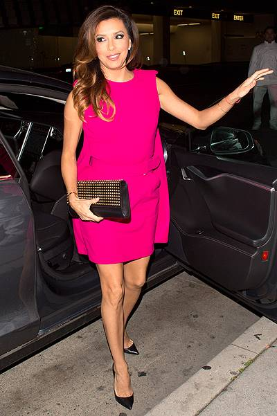 Eva Longoria wearing a stunning electric pink dress was seen arriving at Mr. Chow restaurant in Beverly Hills, CA with her new man Jose Antonio Baston