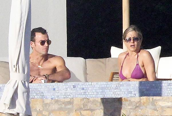 Jennifer Aniston and fiancee, Justin Theroux spend time on holiday in Los Cabos with celebrity friends, Emily Blunt, Howard Stern and Beth Ostrosky Stern Featuring: Jennifer Aniston,Justin Theroux Where: Los Cabos, Mexico When: 28 Dec 2013 Credit: WENN.c