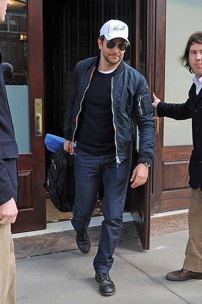 "Bradley Cooper is still a part of an A-team. He carries back pack with sign ""The A team"" as he checked out from his Tribeca hotel yesterday with girlfriend Suki Waterhouse in NYC"