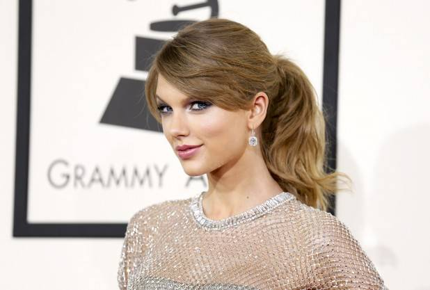 Pop artist Taylor Swift arrives at the 56th annual Grammy Awards in Los Angeles