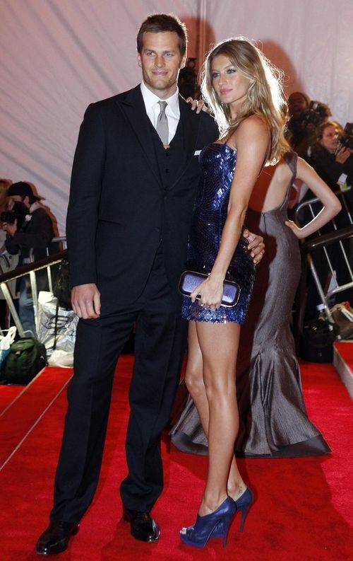 New England Patriots quarterback Tom Brady and his wife model Gisele Bundchen pose at the Metropolitan Museum of Art Costume Institute Gala, The Model As Muse: Embodying Fashion in New York
