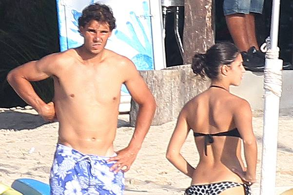 Rafael Nadal goes shirtless while his girlfriend Maria Xisca Perello bares her bikini body while spending a romantic time in the sea of Cancun, Mexico