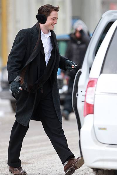 Robert Pattinson walks to his trailer after filming a scene for 'Life' in Canada