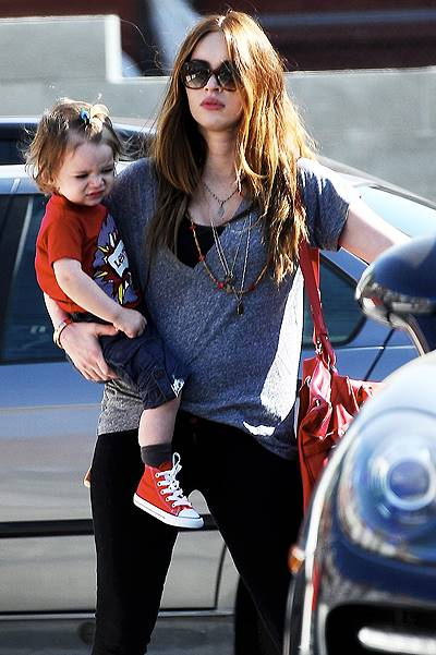 Pregnant Megan Fox carries son Noah as she leaves DMH Aesthetics medical facility in Larchmont Village. Little Noah is spotted with what looks like a blue elastic hair band in his bangs. Featuring: Megan Fox,Noah Green Where: Los Angeles, California, Uni