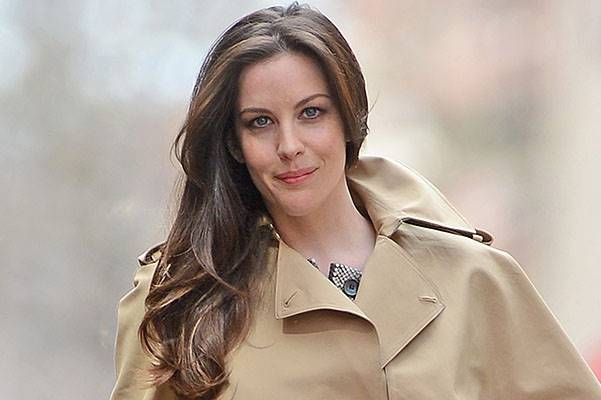 Liv Tyler poses in trench coat for fashion photo shoot in New York City