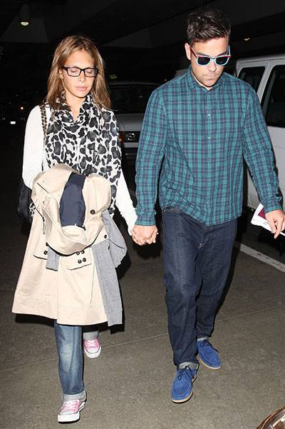 Robbie Williams with his blue suede shoes and blue checked shirt arrives in LA with girlfriend Ayda Field Los Angeles, California - 16.09.09 When: 16 Sep 2009 Credit: WENN
