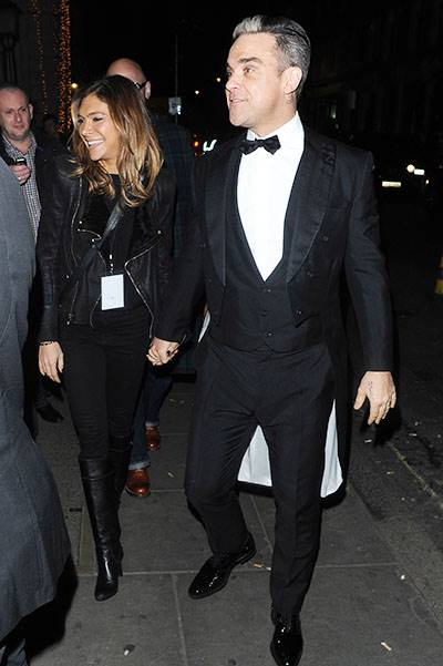 Royal variety show departures at the London Palladium. Celebs including Jessie J , Gary Barlow, Robbie Williams, John Newman and Mary J Blige are seen leaving the Pladium after their performances. Featuring: Robbie Williams,Ayda Field Where: London, Unit