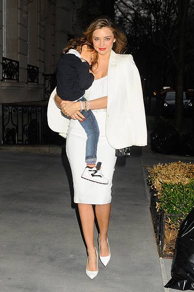 Miranda Kerr dresses in all white while carrying baby Flynn two days before her birthday