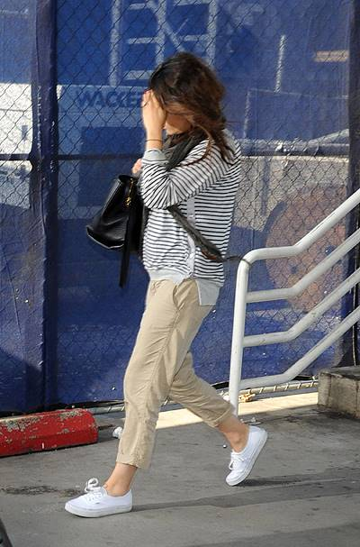 Ashton Kutcher and rumoured to be pregnant fiance Mila Kunis touch down at LAX airport
