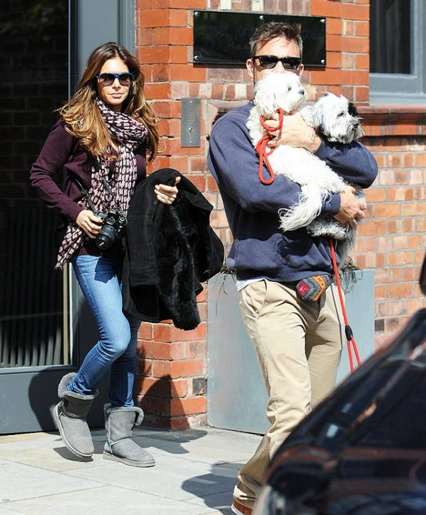 Robbie Williams and wife leave Great John Street hotel in Manchester todayhe sheilded his face with his two dogs.
