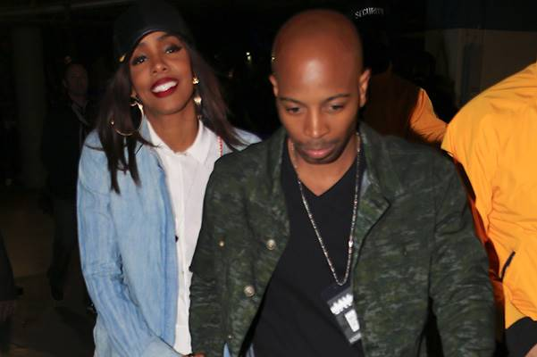 Kelly Rowland and fiance Tim Witherspoon hold hands as they leave the Jay Z concert at the Staples Center in Los Angeles on Monday night