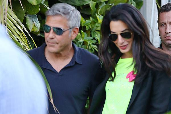 George Clooney and his lawyer fiancee hold hands in Malibu