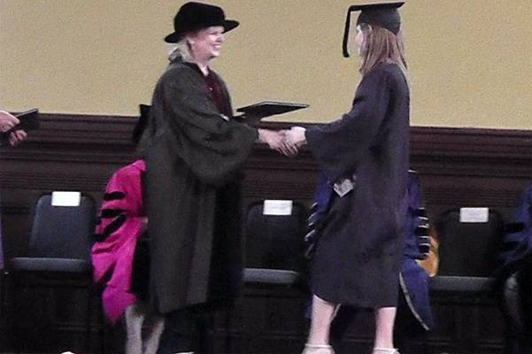 EXCLUSIVE: Emma Watson goes up to the stage to get her diploma while wearing her cap and gown and heels at Brown University, Providence, RI