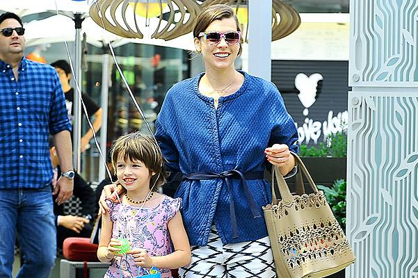 EXCLUSIVE: Milla Jovovich all smiles while out shopping with her daughter Ever in Los Angeles, CA