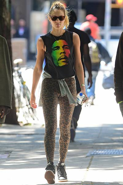 EXCLUSIVE: Candice Swanepoel wears Bob Marley shirt and leopard tights in Soho, NYC
