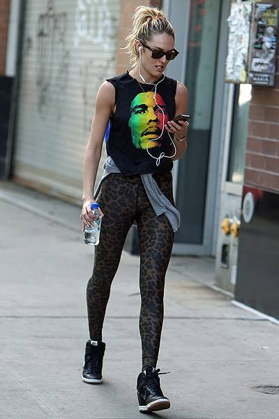EXCLUSIVE: Victoria Secret model Candice Swanepoel walks around SoHo with a Bob Marley t-shirt and leopard tights in New York City