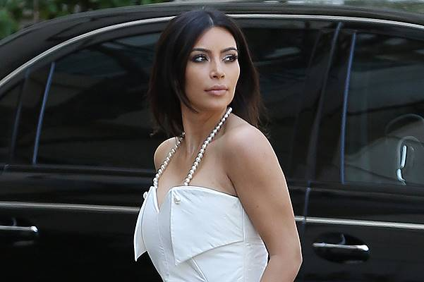 Kim Kardashian dressed all in white as she films Keeping up with the Kardashians at a Beverly Hills hotel