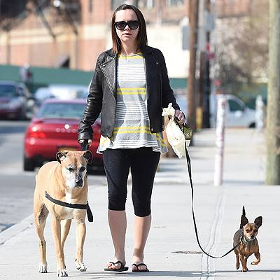 EXCLUSIVE: Pregnant Christina Ricci walks her two dogs in Battery Park, NYC