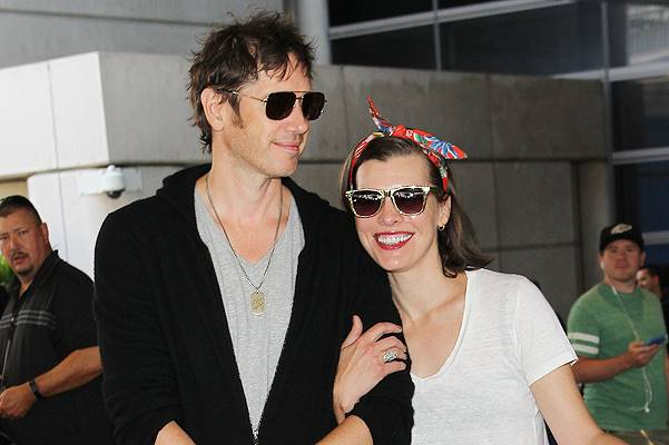 Milla Jovovich and Paul W. S. Anderson at Los Angeles International Airport (LAX) Featuring: Paul W. S. Anderson,Milla Jovovich Where: Los Angeles, California, United States When: 28 May 2014 Credit: WENN.com