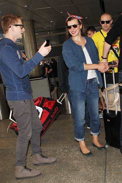 Milla Jovovich and Paul W. S. Anderson at Los Angeles International Airport (LAX) Featuring: Milla Jovovich Where: Los Angeles, California, United States When: 28 May 2014 Credit: WENN.com