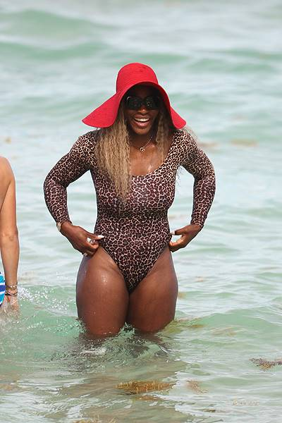 Serena Williams in a leopard print bodysuit at the beach in Miami