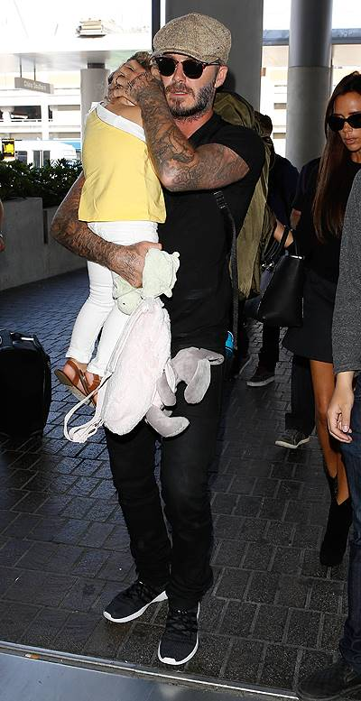 David and Victoria Beckham leave Los Angeles International (LAX) airport with their children Featuring: Harper Beckham,David Beckham,Victoria Beckham Where: Los Angeles, California, United States When: 31 May 2014 Credit: WENN.com