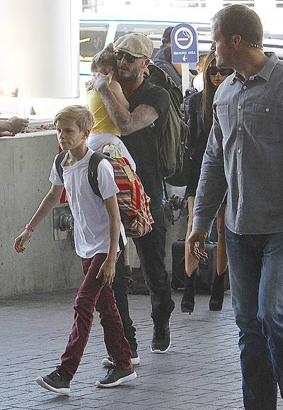 David and Victoria Beckham leave Los Angeles International (LAX) airport with their children Featuring: Harper Beckham,David Beckham,Victoria Beckham,Romeo Beckham Where: Los Angeles, California, United States When: 31 May 2014 Credit: WENN.com