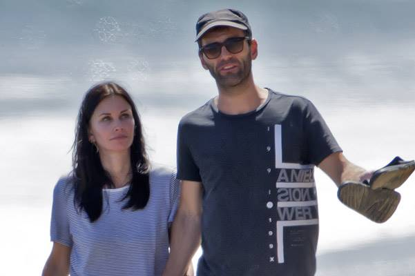 EXCLUSIVE: Courteney Cox shares a tender kiss with her boyfriend while walking on the beach in Malibu