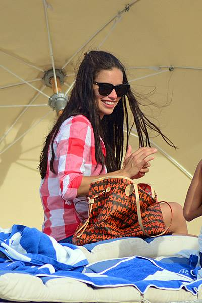 Adriana Lima pictured smiling on the beach in Miami after seperation from husband