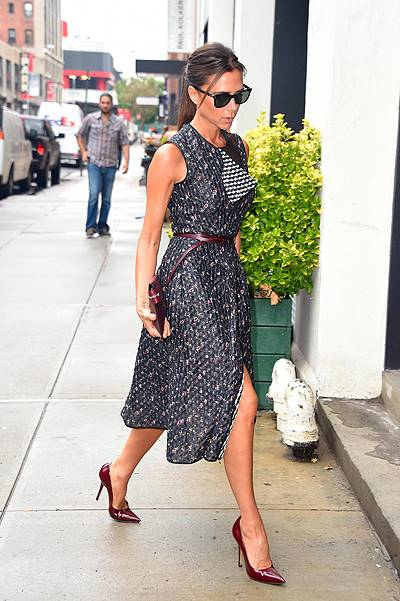 Victoria Beckham shows off her toned legs