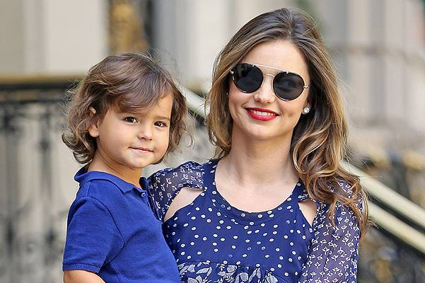 Miranda Kerr is all smiles as she steps out with her son Flynn Bloom in New York City