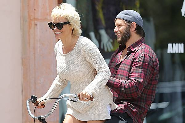 Pam Anderson rides bike in Malibu and gives husband Rick Solomon a ride on the back of her bike.