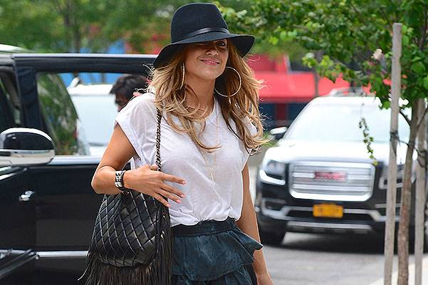 Jennifer Lopez is sexy in a mini skirt and wide brim hat in NYC