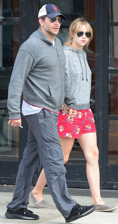 EXCLUSIVE: Actor Bradley Cooper and his girlfriend Suki Waterhouse stop and chat with some friends as they walk hand in hand along Abbot Kinney Boulevard in Venice, CA after having breakfast at 3 Square Cafe