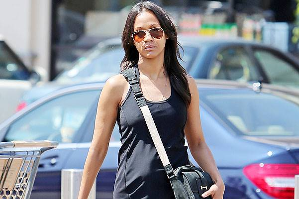 EXCLUSIVE: Zoe Saldana reveals a potential baby-bump in tight fitting clothes