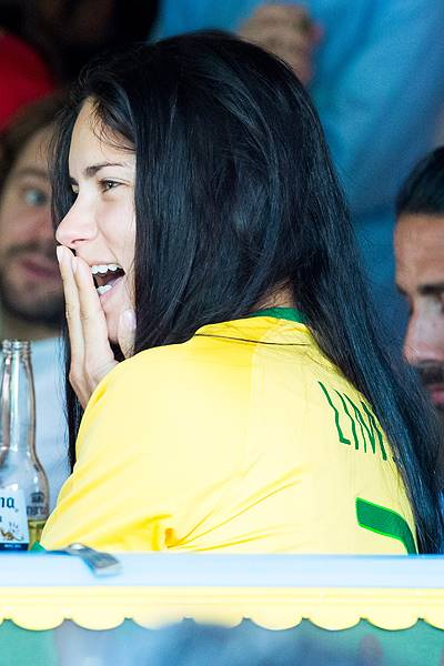 Models Alessandra Ambrosia and Adriana Lima watch the Brazil vs Germany World Cup match