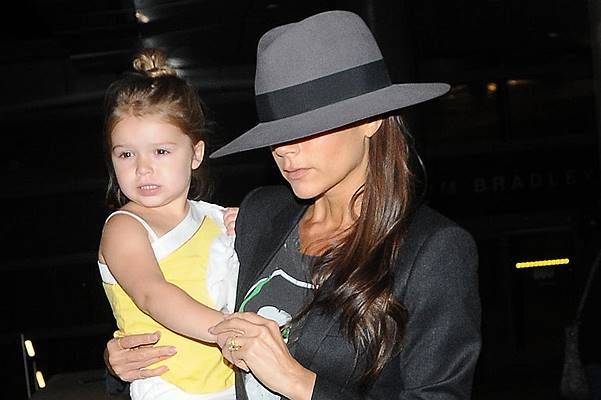 Victoria Beckham arrives at Los Angeles International (LAX) airport carrying daughter Harper Featuring: Victoria Beckham,Harper Beckham Where: Los Angeles, California, United States When: 18 Jul 2014 Credit: WENN.com