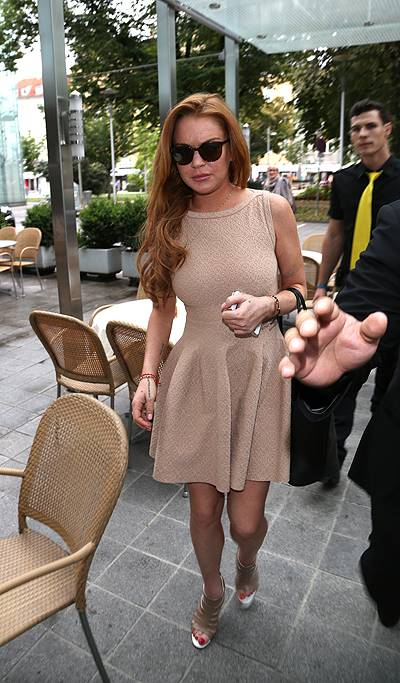 EXCLUSIVE: Lindsey Lohan arrives at her hotel in Linz, Austria