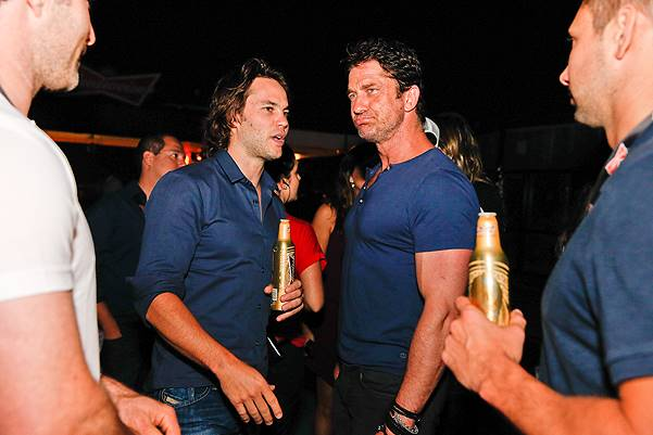 *EXCLUSIVE* Taylor Kitsch and Gerard Butler share a cold one in Rio