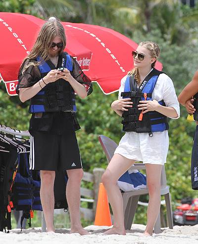 Actress Chloe Grace Moretz and brother wear life jackets on the beach in Miami Beach