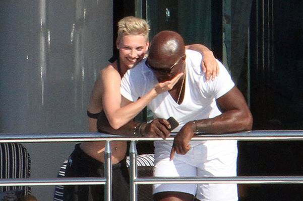 Seal seen enjoying a holiday on a yacht in Sardinia with a mystery blonde woman and some friends