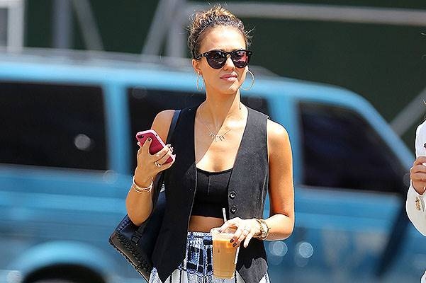 Jessica Alba seen out and about wearing a tank top under a vest showing off her stomach in NYC