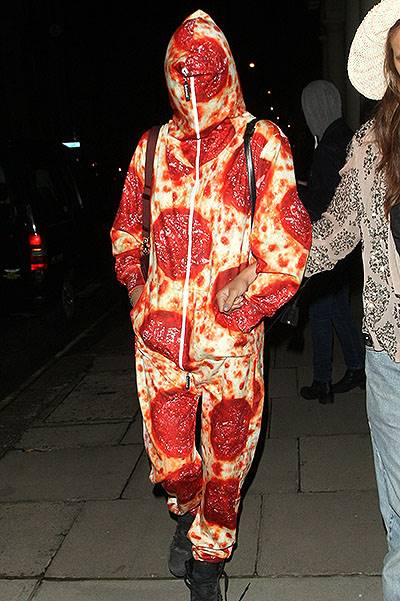 Cara Delevingne arriving home from Ibiza wearing a Pepperoni Pizza Onesie