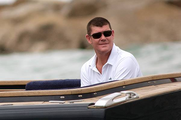 EXCLUSIVE: ** PREMIUM RATES APPLY ** James Packer is taken to his super yacht in Sotogrande, Spain on August 12, 2014